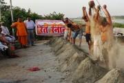 To protest Yamuna water crisis, activists take 'sand bath'