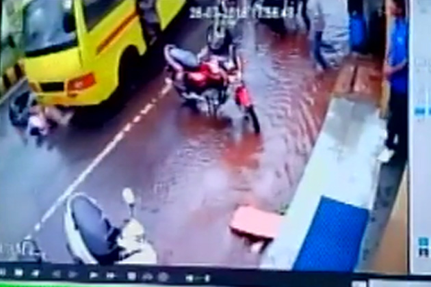 WATCH: Miraculous escape for two after being run over by a bus