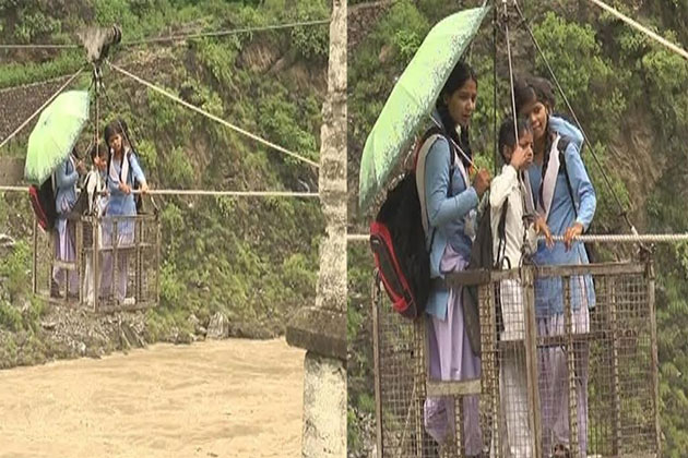 Uttarakhand rains: Pauri students use rope trolley to cross Alaknanda river flowing close to danger mark