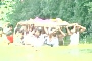 WATCH: Locals forced to carry body through a pond after goons block path to cremation ground