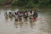 Students risk their lives, swim across river to reach school
