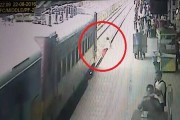 WATCH: Woman jumps in front of train, miraculously survives