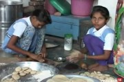 Mid-day meal is prepared by young girls in this primary school