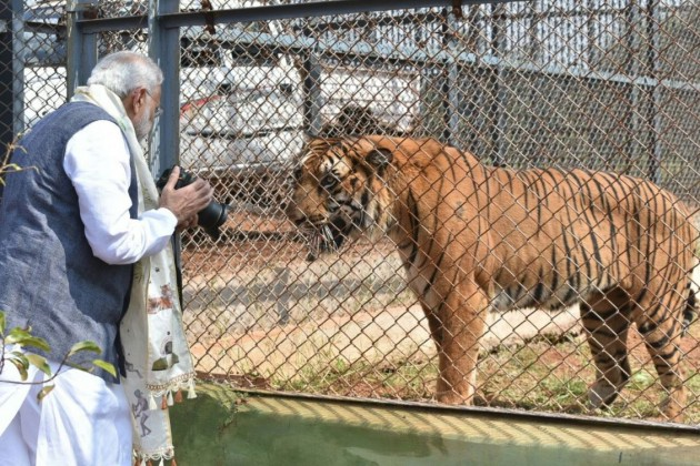 Photos of Modi displaying his hobby for taking pictures has been doing rounds on the social media.