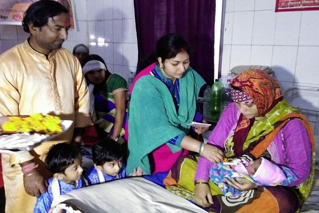 He gathered his friends and family at the hospital, and presented each baby with a silver coin.